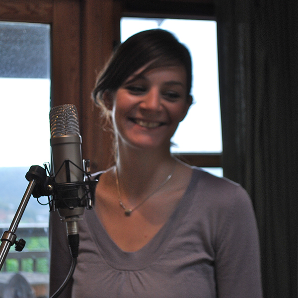 Laura smiling away from the microphone. - © 2010 Sam Carroll